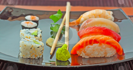 Sushi stock photo, Close up of sushi over a black plate by Fabio Alcini