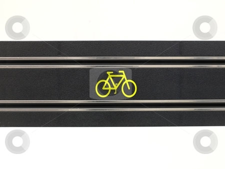 Bicycle Lane stock photo, An image of a toy slot car racing track with a bicycle symbol by Kitch Bain