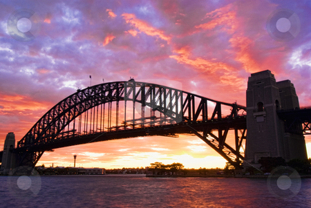 Sydney Harbour Bridge At Dusk stock photo, Sydney Harbour Bridge At Dusk with firing sky in background by mroz