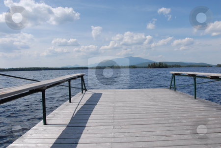Dock view stock photo, A dock overlooking Lake Millinocket with a view of Mt. Katahdin in Maine. by Tim Markley