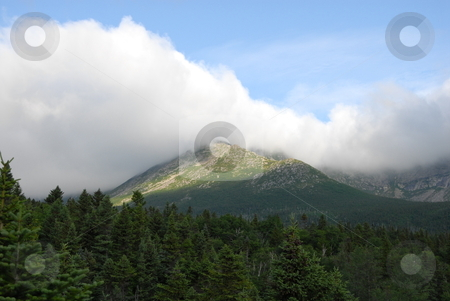 Mountain View stock photo, A view of Mt. Kathdin in Maine during the summer time. With clouds rolling over. by Tim Markley