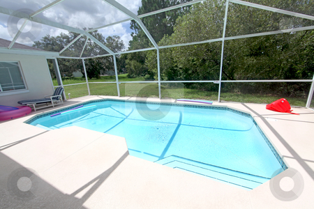 Swimming Pool stock photo, A Swimming Pool overlooking a Conservation Area by Lucy Clark
