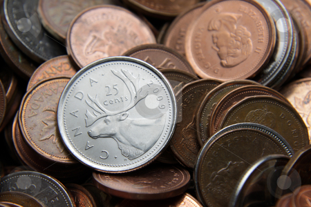 Canadian Quarter stock photo, Canadian Quarter and other coins. Canada, July 3rd, 2011: A Canadian Quarter with other coins in the background.  The Canadian currency is usually close in value to that of the US dollar. by Chris Hill