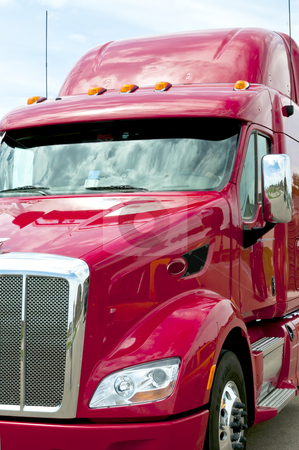 Close up of a red semi truck stock photo, New red semi truck ready to go to work. by RCarner Photography