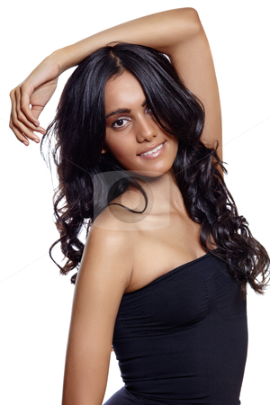 Beauty woman with long balck curly hair stock photo, beautiful woman with long black curly hair, tanned skin and natural make-up over white background. by lubavnel