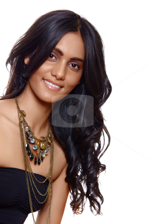 Smiling woman with long hair stock photo, beautiful woman with long black curly hair, tanned skin and natural make-up over white background by lubavnel