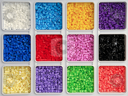 Toy pearls in many colors stock photo, Toy pearls in many colors by Lars Christensen