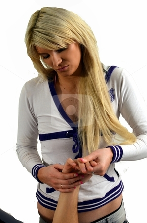 Hand treatment stock photo, Attractive blond massage therapist giving a massage to the back of a client's hand. Isolated. by ianmck