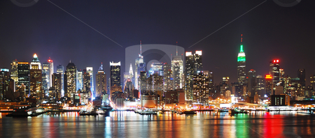 NEW YORK CITY NIGHT SKYLINE PANORAMA  stock photo, New York City night skyline panorama over Hudson river with boat and skyscraper and colorful reflections. by rabbit75_cut