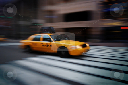 NEW YORK CITY YELLOW CAB  stock photo, New York yellow cab taxi speeding across sidewalk.  by rabbit75_cut
