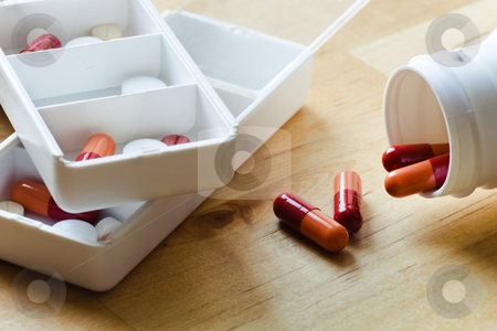 Pills, capsules and tablets sorted in pillbox stock photo, Pills, capsules and tablets sorted in medicine box for use as daily medication by Colette Planken-Kooij