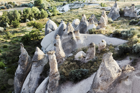 Early morning aerial of fairy chimneys stock photo, aerial view of semicircle of fairy chimneys, naturally weathered limestone with small ravene, copy space, crop area, landscape, vista by Kantilal Patel