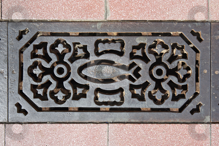 Sewer grate stock photo, Decorated sewer grate in a street of Vila Real de Santo Antonio, Algarve, Portugal by Manuel Ribeiro