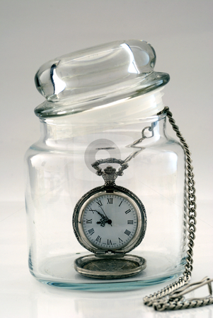 Old pocket watch in a glass jar – Time in a Bottle stock photo, Old pocket watch in a glass jar – Time in a Bottle by johnkwan