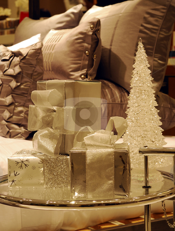Wrapped Christmas gifts on a glass table next to the bed (converted to monotone) stock photo, Wrapped Christmas gifts on a glass table next to the bed (converted to monotone) by johnkwan
