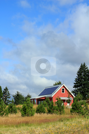 Natural Power stock photo, Small, red public park building with solar panels on the metal rooftop on a mostly sunny summer day. by Lee Serenethos