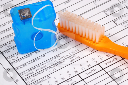 Dental claim form with toothbrush concepts of the rising cost of dental care stock photo, Dental claim form with toothbrush concepts of the rising cost of dental care by johnkwan