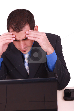 Image of businessman touching his head while looking at monitor  stock photo, Image of businessman touching his head while looking at monitor with tired expression   by dacasdo
