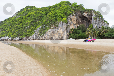 The mountains and the green area. stock photo, Small motorboat on the beach in Thailand by Na8011seeiN