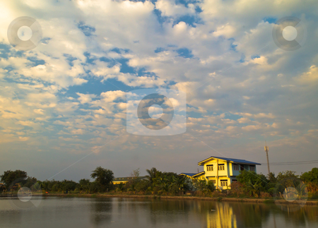 House beside the fish pond at the evening. stock photo, House beside the fish pond at the evening. by Na8011seeiN