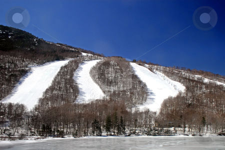 Ski Slopes stock photo, Many ski slopes in winter with frozen lake at bottom by Lucy Clark
