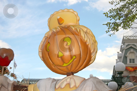 Pumpkin stock photo, A pumpkin with candy corn hat and toffee apple by Lucy Clark