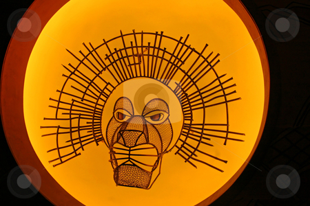 Lion Mask stock photo, A lion mask on a bright yellow background by Lucy Clark