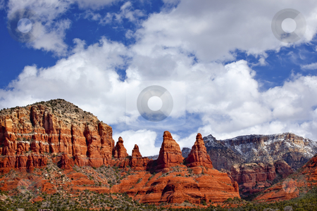 Madonna Nuns Orange Red Rock Canyon Big Blue Cloudy Sky Sedona A stock photo, Madonna Nuns Orange Red Rock Canyon Big Blue Cloudy Sky Green Trees Snow Sedona Arizona by William Perry