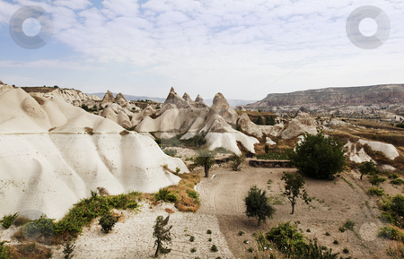 Aerial view of Cappadocia terrain stock photo, Landscape of Cappadocia limestone rock region, naturally wind weathed, man made cave houses, crop area, copy space by Kantilal Patel