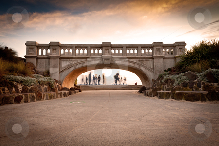 Beach Bridge stock photo, foot bridge with people walking in the background by HughAdams
