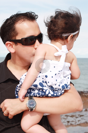 Father kissing his baby stock photo, father kissing his baby  by dacasdo