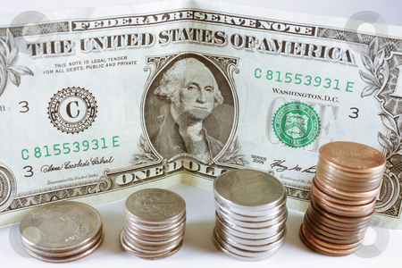 Currency stock photo, Piles of pennies, nickels, dimes and quarters in front of a one dollar bill isolated on a white background by photolady