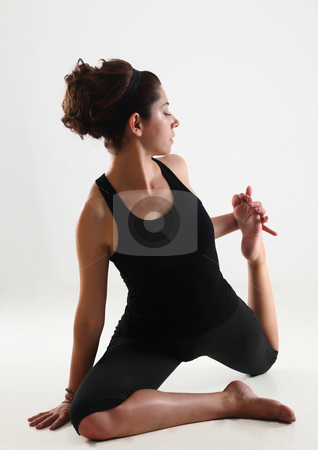 Girl and yoga stock photo, Young girl in black practice yoga and relaxation by Roberto Giobbi