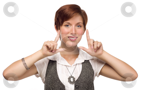 Pretty Young Adult Female Framing Face with Fingers stock photo, Pretty Smiling Young Red Haired Adult Female Framing Face with Fingers Isolated on a White Background. by Andy Dean