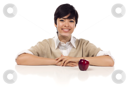 Smiling Mixed Race Young Adult Female Sitting with Apple stock photo, Smiling Mixed Race Young Adult Female Sitting at White Table with Apple Isolated on a White Background. by Andy Dean