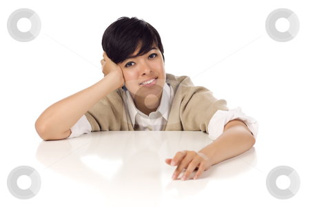 Smiling Mixed Race Young Adult Female Sitting at White Table stock photo, Smiling Mixed Race Young Adult Female Sitting at White Table Isolated on a White Background. by Andy Dean