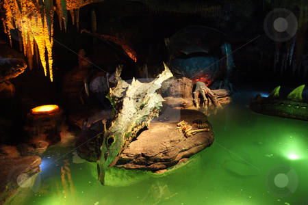 Dragon stock photo, A Dragon asleep in a cave with green water by Lucy Clark