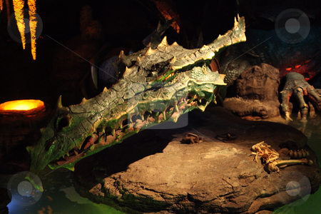 Dragon stock photo, A Dragon in a cave laying on a rock by Lucy Clark