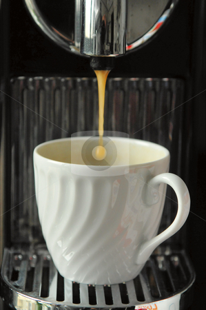 Pouring espresso stock photo, coffee cup at espresso machine by João Almeida