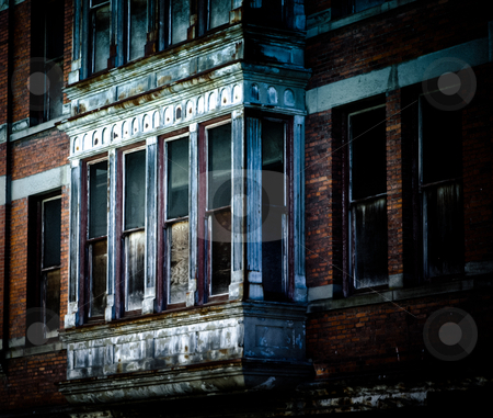 Scary house stock photo, an old brick scary house with white windows by Anatoliy Nykilchyk