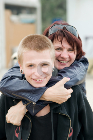 Mother and son stock photo, The happy mother and a son hugging and laughing by Salauyou Yury