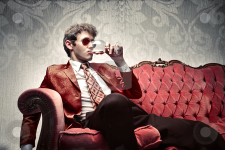 Luxury stock photo, Handsome young man drinking a glass of wine by olly4