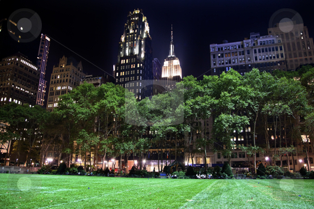 Bryant Park New York City Skyline  Night stock photo, Bryant Park New York City Green Grass Skyline Apartment Buildings Empire State Building Night by William Perry