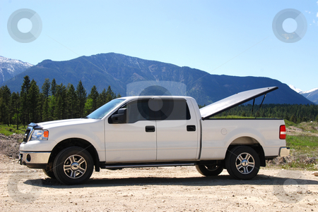 White Pick-up truck stock photo, Pick-up truck on a dirt road in the mountains. by Damien Richard
