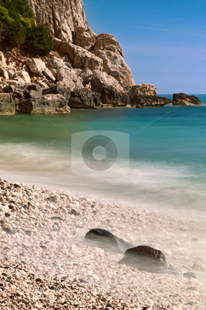 Rocky beach high cliffs blue sea  stock photo, rocky beach high cliffs blue sky and sea Sardinia Italy sardegna tourism and travel by Dirk Ercken