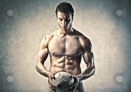 Sport stock photo, Handsome bare-chested man holding a volleyball by olly4