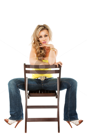 Gorgeous female sitting on a chair stock photo, beautiful young woman with casual outfit sitting on a chair by vilevi