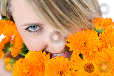 Woman eye bouqet stock photo, Close-up of beautiful female face holding marigolds, colourfull eye looking at camera by vilevi
