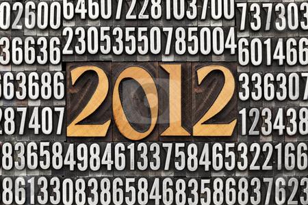 Year 2012 in letterpress type stock photo, 2012 number in vintage wood letterpress printing blocks surrounded by random metal numbers by Marek Uliasz