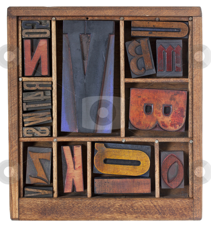 Antique letterpress printing blocks stock photo, a variety of vintage letterpress printing blocks with big letter V in a small wooden typesetter box with dividers, isolated on white by Marek Uliasz